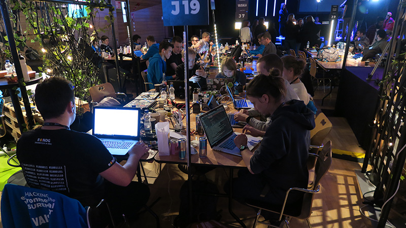 Software developers are working frantically on Vaisala's challenges at Junction 2018.