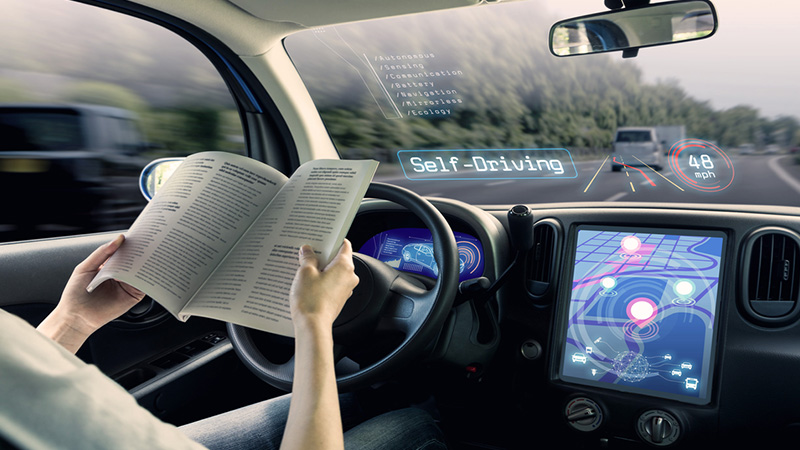 Self-driving vehicle, driver reading