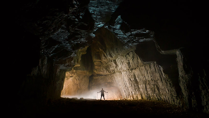 Human in a cave entrance in France