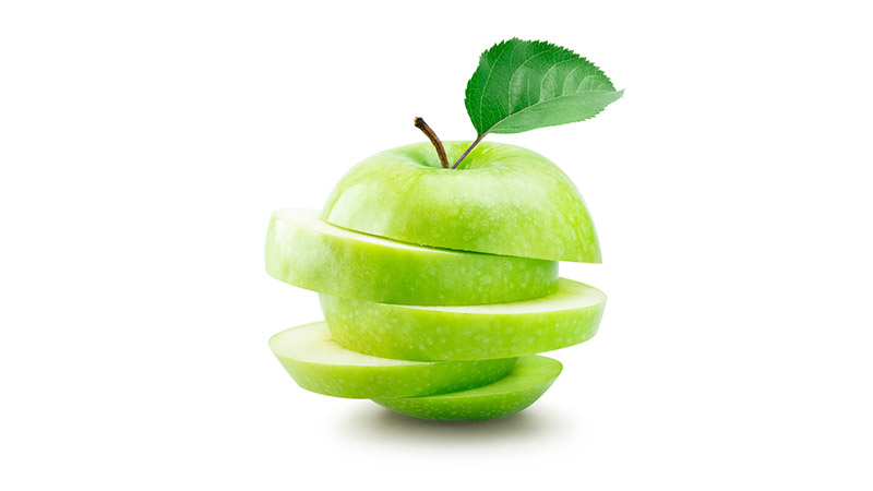 A sliced green apple