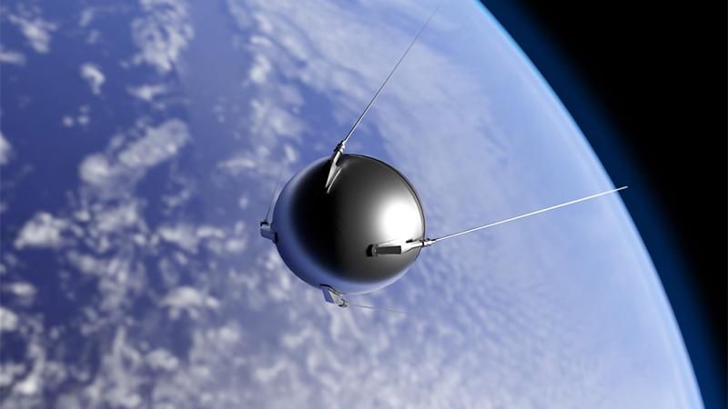 "An illustration of the first artificial satellite ""Sputnik"" launched by the Soviet Union in 1957 orbiting the Earth"