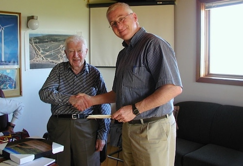 Jack Templin shaking hands with Carl Brothers, a previous Templin award winner