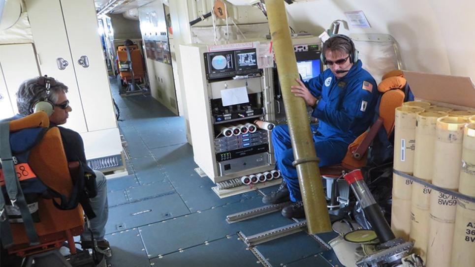 NOAA Aircraft Operations Center technician, Mr. Damon Sans Souci, preparing to launch an expendable into a storm from the WP-3D Orion Hurricane Hunter.