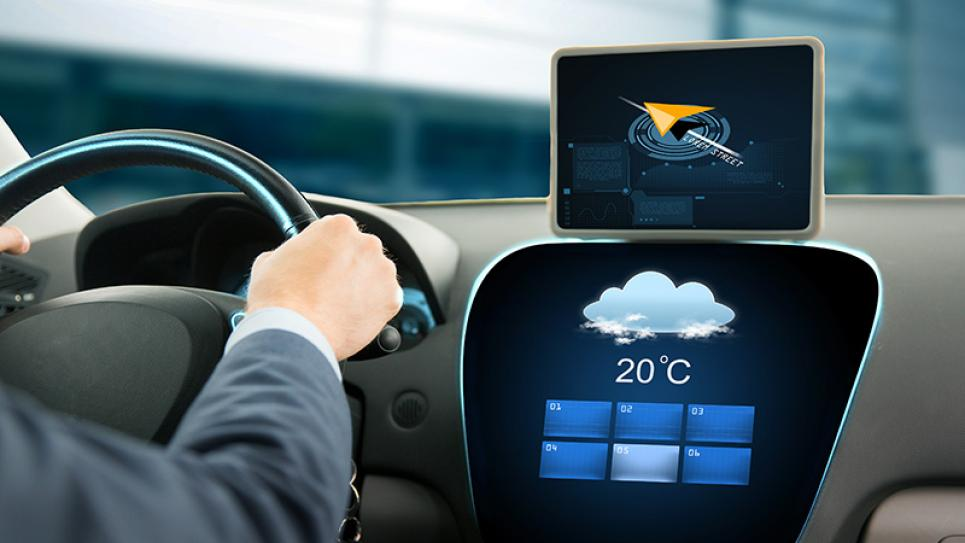 Driver in a car with weather data on screen