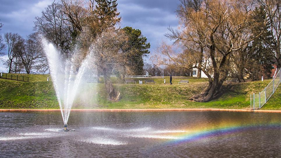 Fountain in the Pärnu River creating a rainbow