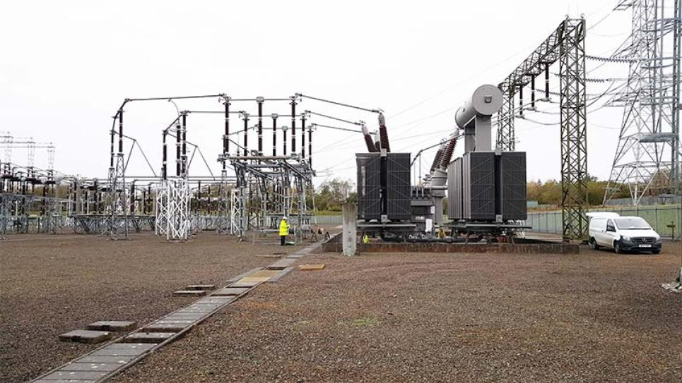 Power transformer and a worker in Scotland, UK